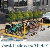 """A row of parked VeoBikes at a downtown Fayetteville """"Hub"""" site."""