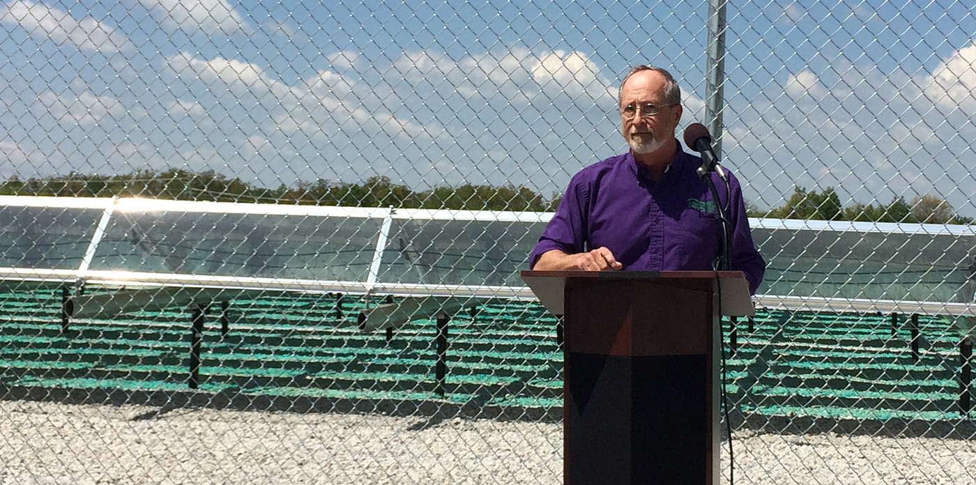 Mayor Lioneld Jordan stands in front of an Ozarks Electric Cooperative solar array during a 2016 eve