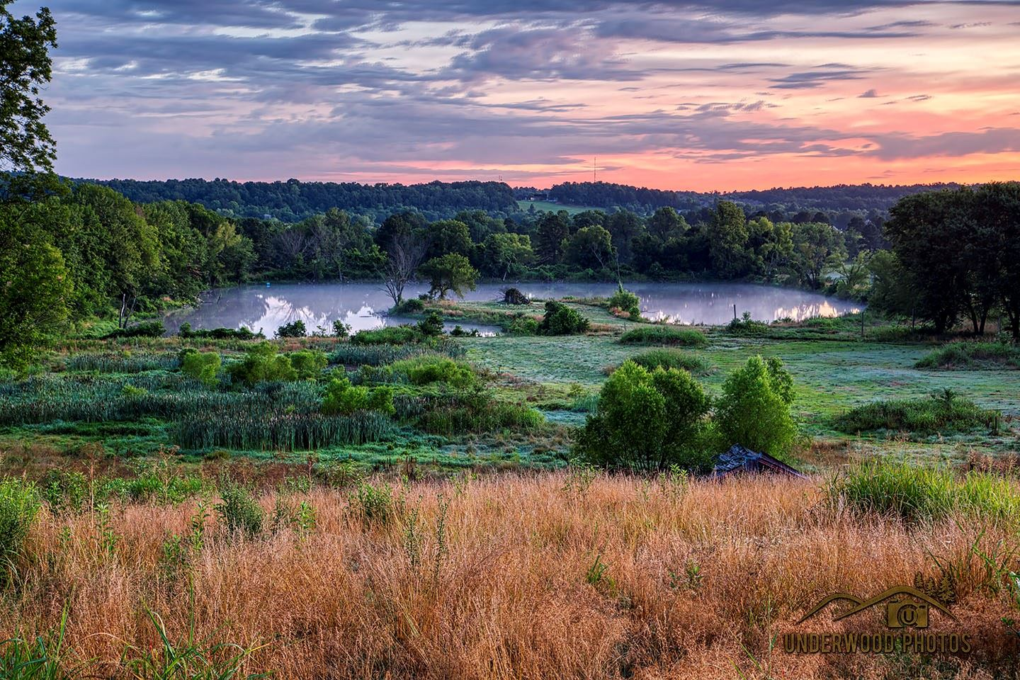 Image of pond and parkland at sunset. Land donated for future Underwood Park