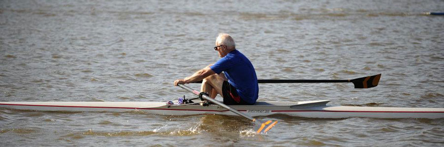 Man rows in lake