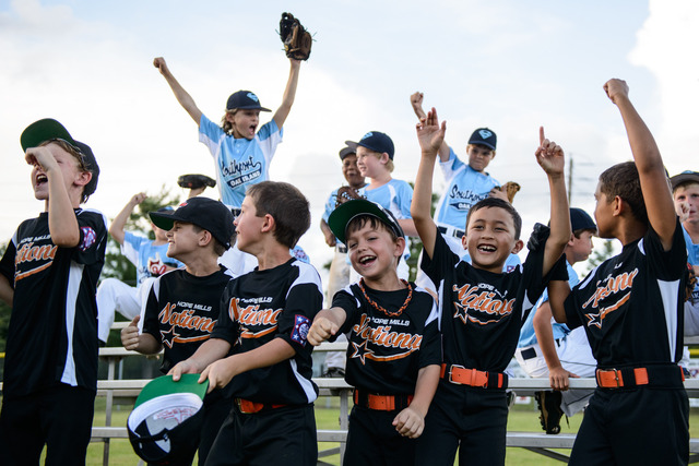Little league teams celebrate together