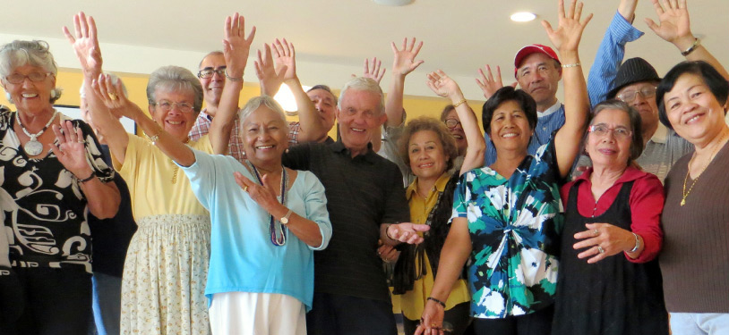Seniors group together and wave at camera