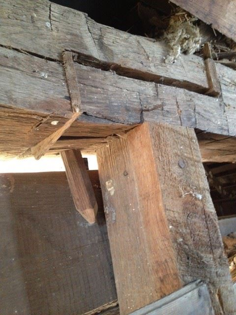 A close image of aged wooden barn rafters