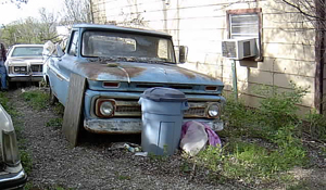 Rusted Truck With Garbage Around