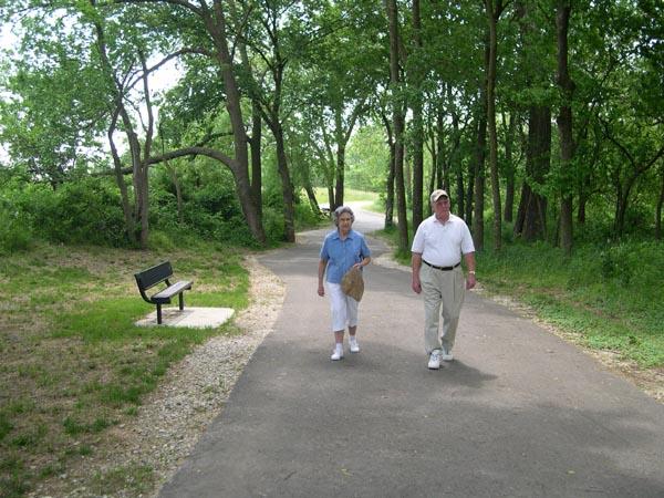 Couple walks down Mud Creek Trail